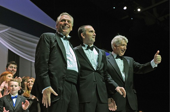 Gov. Terry McAuliffe, Lt. Gov. Ralph Northam and Attorney General Mark Herring celebrate at their inauguration party earlier this month.