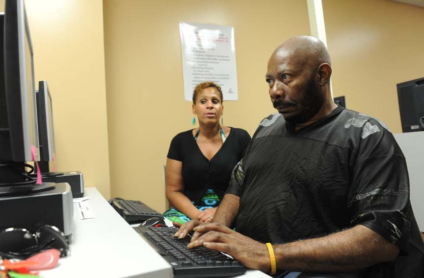 Griffin helps Gerald Fleming search for jobs online. He's 61 and hopes to find an information-technology job, once he earns his certificates in electronics and information technology at J. Sargeant Reynolds Community College.