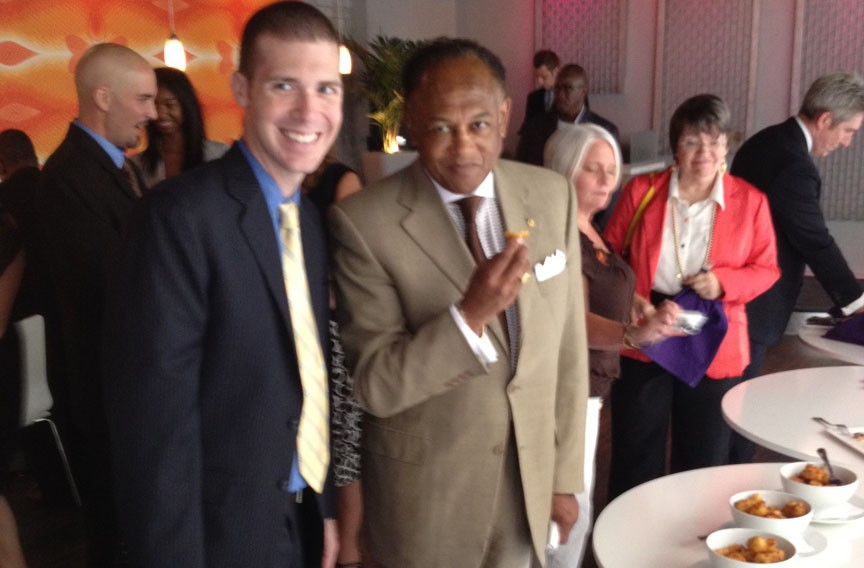 Guided by 2113 co-owner Justin Ayars, Mayor Dwight Jones samples the grand opening spread.