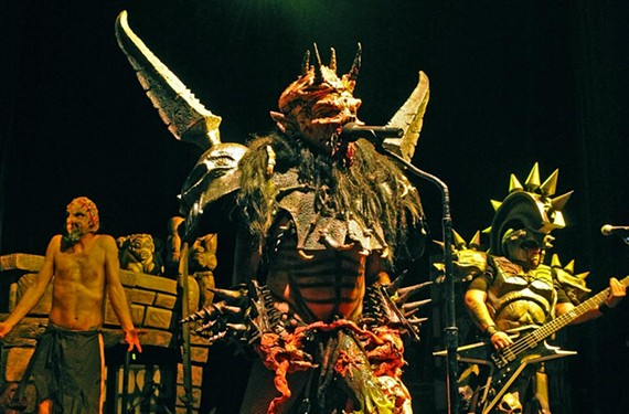 Gwar's David Brockie reigns in full costume as Oderus Urungus during the band's March 16 show at the National. - SCOTT ELMQUIST