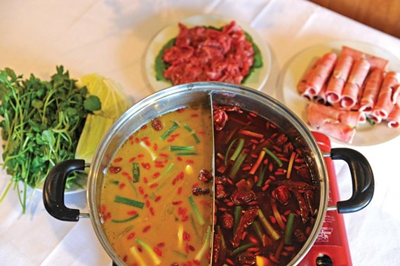 Half broth, half spice make dipping into the hot pot at King of Szechuan a doubly intriguing proposition. - SCOTT ELMQUIST