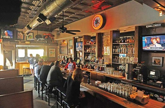 Happy hours ahead: Buddy's manager Angie Dudley tends bar on Thursday afternoon last week, after influence from several thousand patrons helped save the watering hole from losing its lease at the end of the year. - SCOTT ELMQUIST