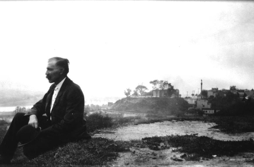 Harry Stilson gazes toward the James River in this self-portrait taken on Chimborazo Hill looking west with Libby Hill and the vertical Confederate Soldiers and Sailors Monument in the distance. - COPYRIGHT RICHMOND IN SIGHT