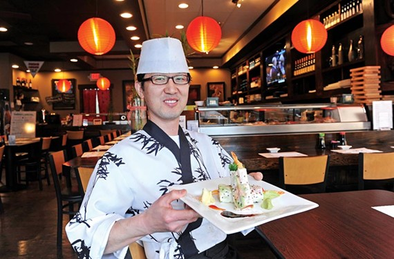 Head chef Sam Han shows the well-stuffed sushi burrito at Sushi Box off Robious Road in Midlothian. - SCOTT ELMQUIST