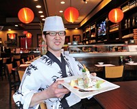 Head chef Sam Han shows the well-stuffed sushi burrito at Sushi Box off Robious Road in Midlothian.