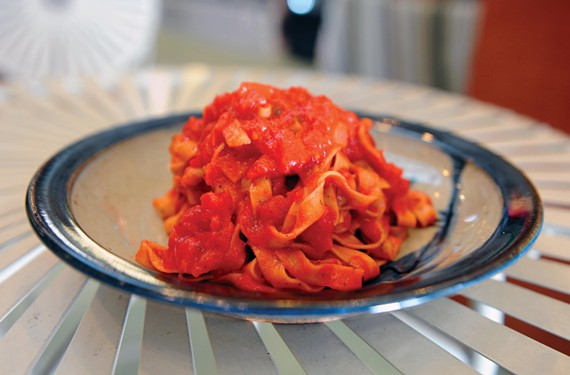 Homemade pasta topped with classic marinara from Bombolini Pasta in the Fan.