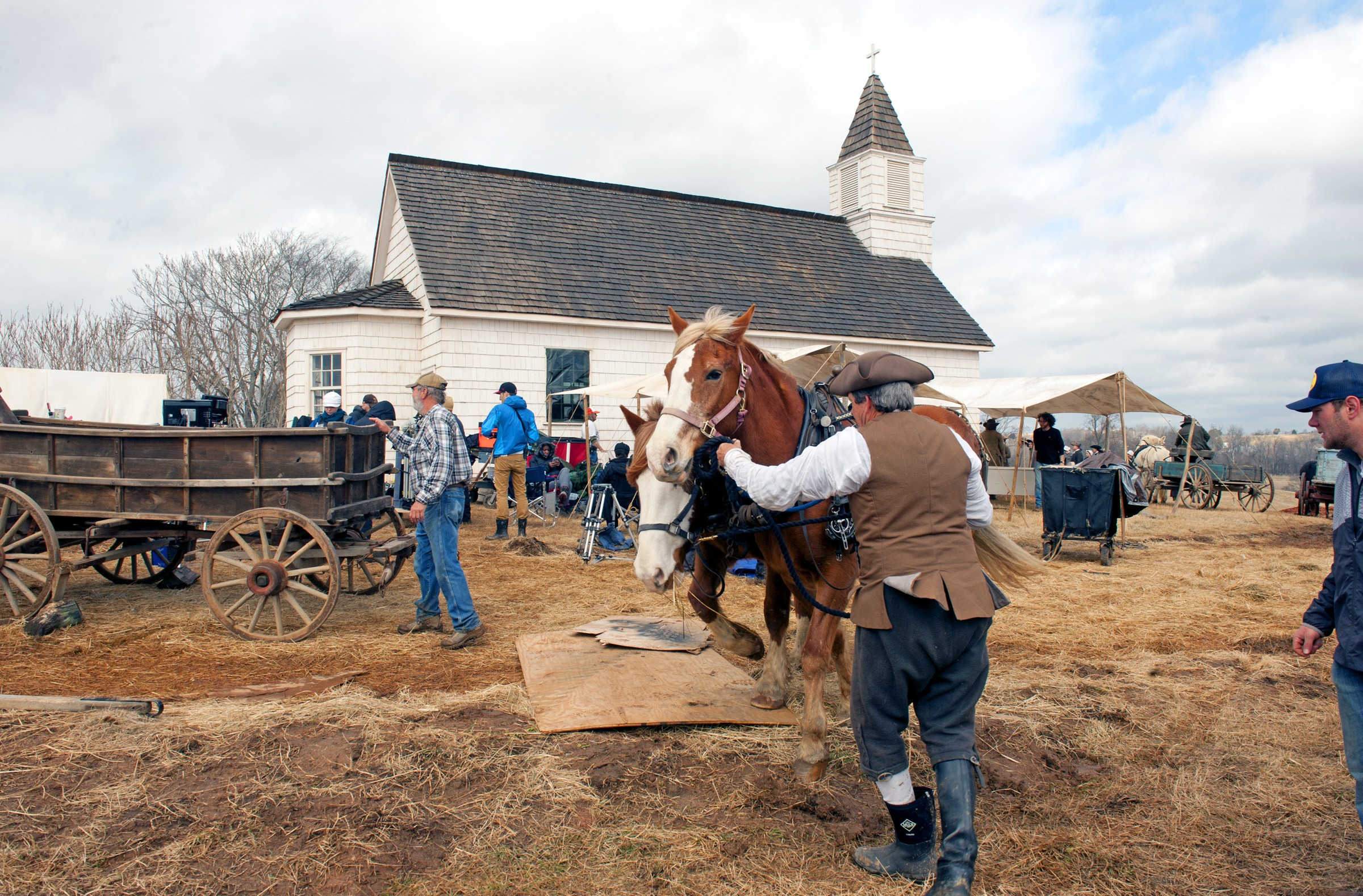 Horses and wagons are prepared for their moment on camera during a scene in episode seven, filmed in February. The church, which sits on top of a hill, was built for the season's pilot, which shot locally in April 2013. - SCOTT ELMQUIST