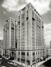 Hotel John Marshall, shown in 1957, has anchored the intersection of North Fifth and East Franklin streets — downtown's highest point geographically — since its completion at the start of the Great Depression in 1929.