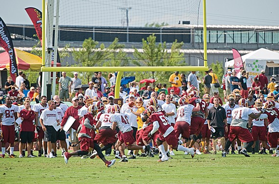 In more hopeful days: opening-week practice at the Redskins Training Camp in Richmond. The team counted an average daily attendance of 10,338. - ASH DANIEL
