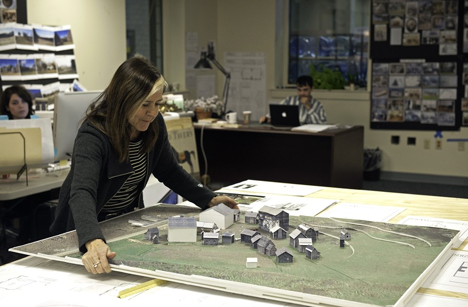 In the art department, Production Designer Caroline Hanania shows a model of the little town of Setauket. Its life-sized version appears on a Goochland County set, with interiors replicated on a sound stage near the Richmond International Raceway. - SCOTT ELMQUIST