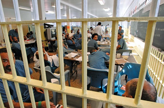 Inmates in a ward of the old city jail, which closed late last year. - SCOTT ELMQUIST