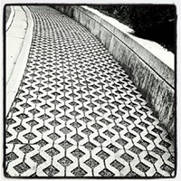 #HiddenRVA on Instagram Instagram by: Cheryl Wimer (@crwphotographs)Where: Outside the Virginia Historical Society off Boulevard.What caught my eye: The lattice pattern of the walkway and curve that draws the eye along its path. It's in a spot where most people don't go around the building.
