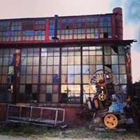 #HiddenRVA on Instagram Instagram by: Spencer L. Turner (bprva)Where: Factory next to the Ambulance Authority on Hermitage Road.What caught my eye: The building had these wonderful panes of glass that were picking up an extraordinary sunset like a faint kaleidoscope. The strange machine closed the deal.