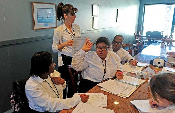Instructor Kathy Schuler reviews job-hunting skills with students Chardanee Harris, Raymond Brooks, Bianca Ellis and Kelly Bailey. - SCOTT ELMQUIST