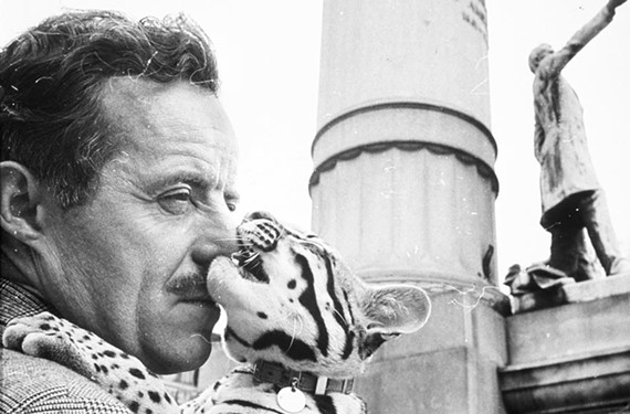 J. Peter Moore, Dali's assistant, and the artist's ocelot, Babou, posed for a photographer on Monument Avenue in April 1966 when Moore presented the artist's concept for the Tompkins statue. - VCU LIBRARIES