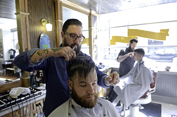 Jacky Flav, a barber and co-owner at High Point Barbershop and Shave Parlor, gives a midmorning cut to Alexander Giles, who recently moved to Richmond.