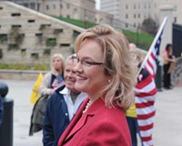 Jamie Radtke, a candidate for the Republican nomination for the U.S. Senate, joined a protest outside the State Capitol last week. She and other candidates weren't invited to the first debate between George Allen and Tim Kaine.