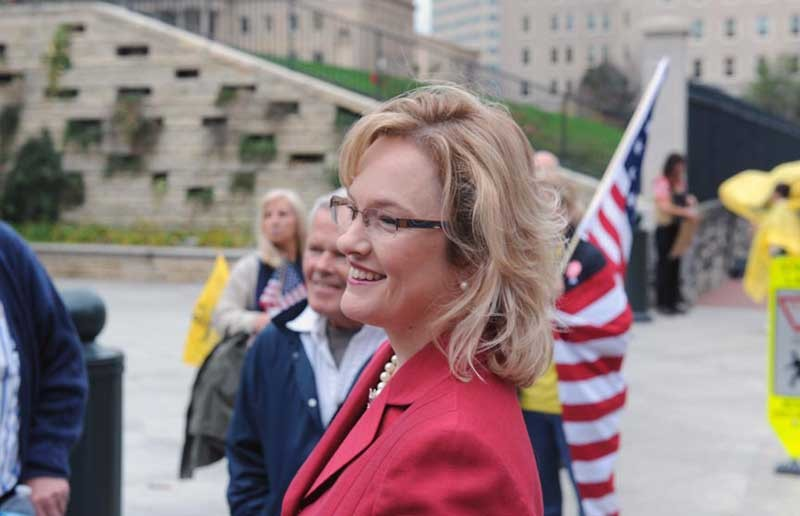 Jamie Radtke, a candidate for the Republican nomination for the U.S. Senate, joined a protest outside the State Capitol last week. She and other candidates weren't invited to the first debate between George Allen and Tim Kaine. - SCOTT ELMQUIST