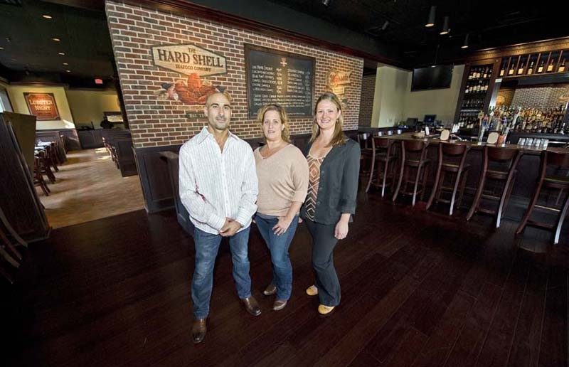 Jared Golden, Michelle Williams and Leandra Dunlevy bring city energy to Midlothian with the second location of the Hard Shell, serving nightly in the Shoppes at Bellgrade on Huguenot Road. - ASH DANIEL