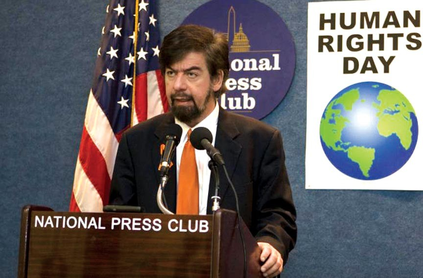 Jeffrey Imm, the founder of a human rights coalition, Responsible for Equality and Liberty, speaks to the National Press Club in Washington in December.