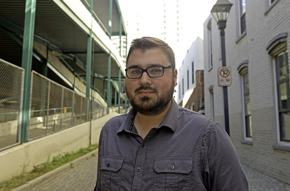 Joe Hinton spent six years developing OccupyTheSystem.org, which held a launch party last week.