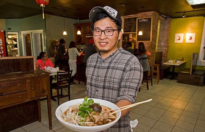 Joe Kiatsuranon shows one of his favorite dishes, the love boat noodle bowl, at his new business, My Noodle & Bar, which opened last weekend on Monument Avenue in the Fan. - ASH DANIEL