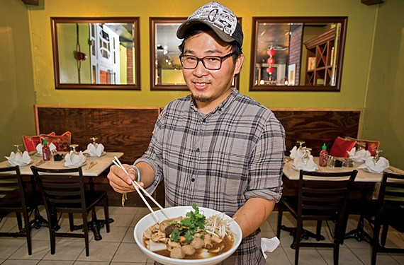 Joe Kiatsuranon shows one of My Noodle & Bar's most popular dishes, the love boat noodle bowl, at his new cafe in the Stuart Court apartment building on Monument Avenue.