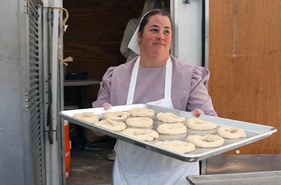 Judy Yoder gets another tray of her addictive doughnuts ready for the fryer.