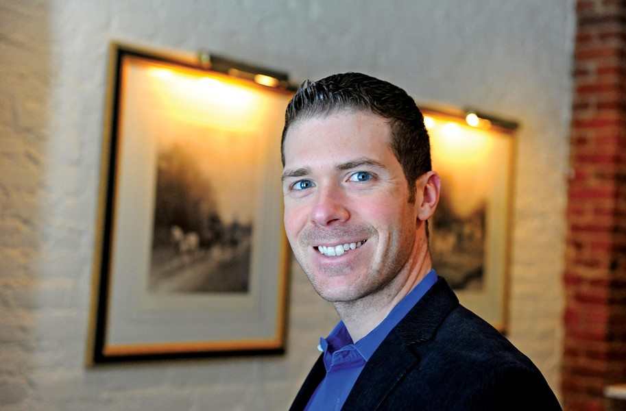 "Justin Ayars, co-owner of 2113 Bistro in Shockoe Bottom, serves as president of the Richmond Business Alliance, an LGBT-friendly chamber of commerce. He says recent advances in the community — and the backlash that's followed — demonstrate Richmond is coming into the 21st century ""kicking and screaming."" - SCOTT ELMQUIST"