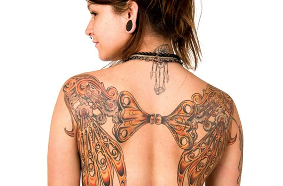 Karma Jane displays a design by Charles Berger of Heroes and Ghosts Tattoo. - TERRY BROWN