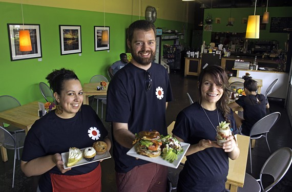 Kelly Barrows, serving up sweets including the gluten-free variety, with owner Noah Yeager and his Bavarian club with fresh harvest salad, and Kay Vanderlyn, showing off a fruit and yogurt parfait.