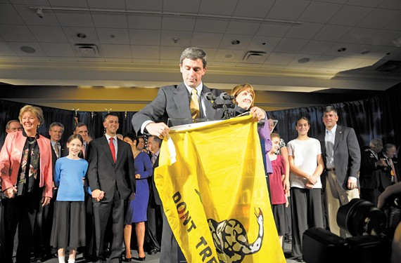 "Ken Cuccinelli, holding a ""don't tread on me"" flag on inauguration night, was ""tea party before the tea party was tea party,"" says longtime political analyst Bob Holsworth. - SCOTT ELMQUIST"
