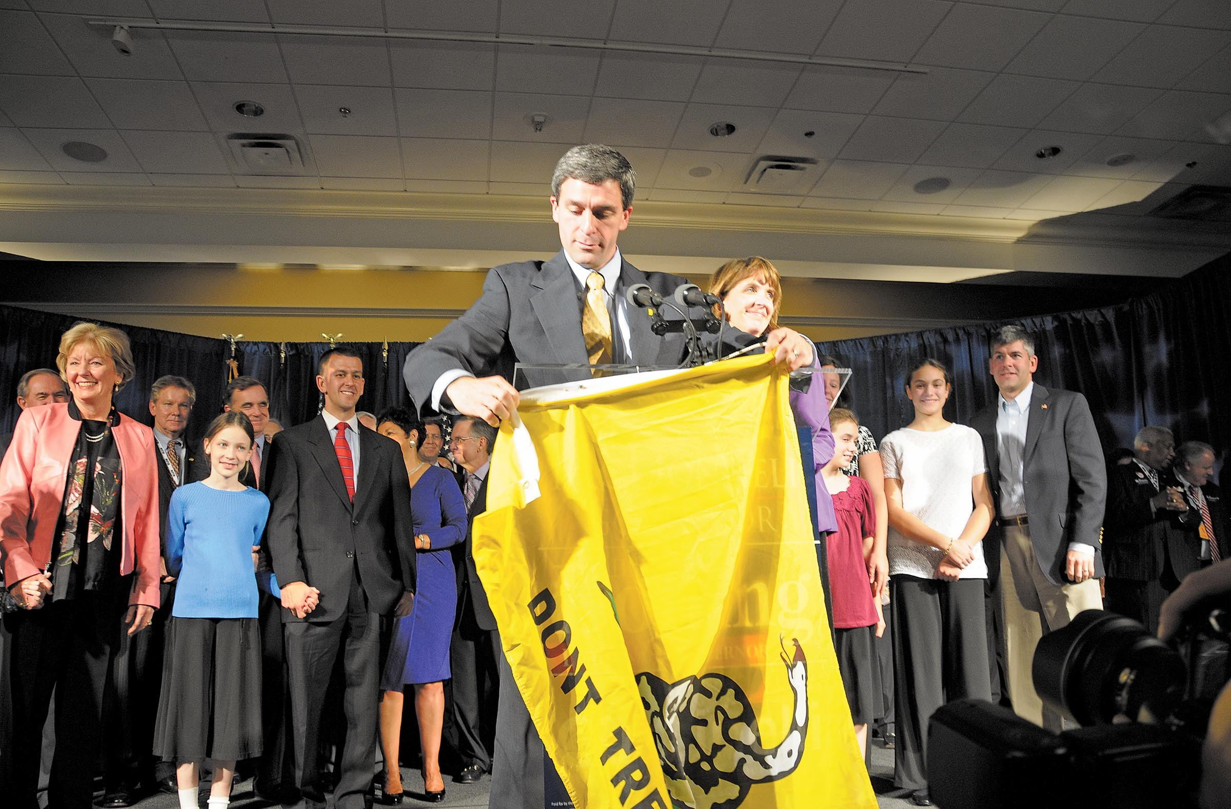 """Ken Cuccinelli, holding a """"don't tread on me"""" flag on inauguration night, was """"tea party before the tea party was tea party,"""" says longtime political analyst Bob Holsworth. - SCOTT ELMQUIST"""