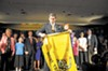 """Ken Cuccinelli, holding a """"don't tread on me"""" flag on inauguration night, was """"tea party before the tea party was tea party,"""" says longtime political analyst Bob Holsworth."""