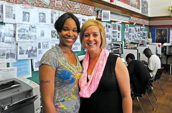 Ke'Shawn Noble, who will graduate from high school June 13, stands with Elizabeth Muse, the program's services coordinator. - SCOTT ELMQUIST