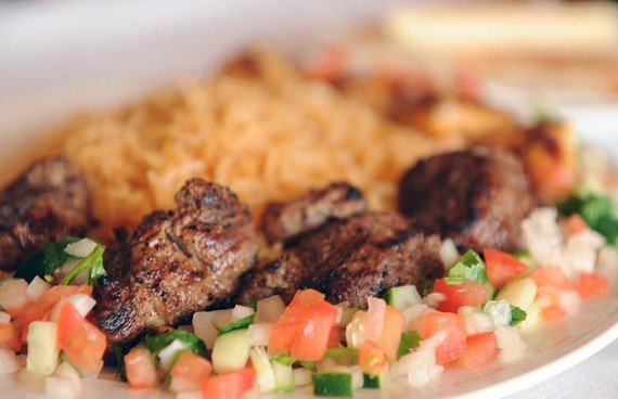 Lamb and chicken kabobs are served off-skewer with rice at The Box Afghan Kabob House in Chesterfield. - SCOTT ELMQUIST
