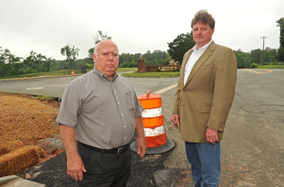 Last stand: David Pendergrast and Andrew Thexton, neighbors of Benedictine College Preparatory's new campus on River Road in Goochland, are making a final effort to stop the move. - SCOTT ELMQUIST