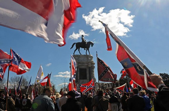 "Last year, hundreds of Confederate sympathizers descended on the Robert E. Lee statue Saturday afternoon, bemoaning Lincoln and the Northern ""invasion"" of the South. - SCOTT ELMQUIST"
