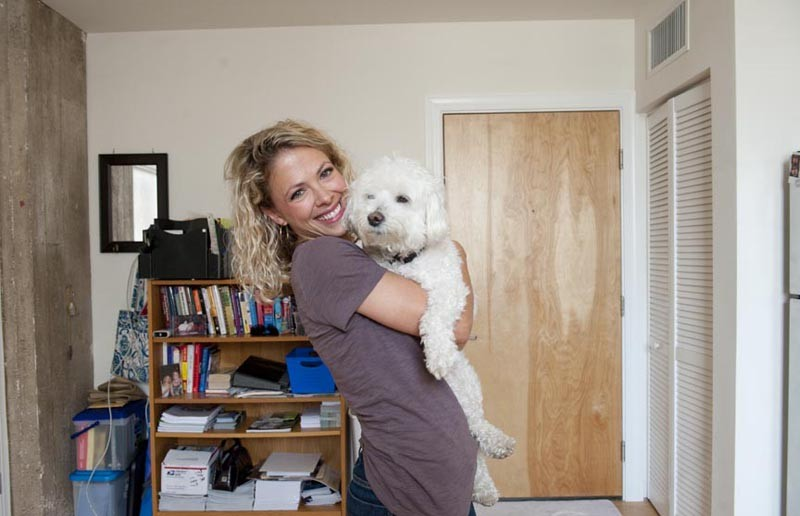 """Laura Donahue, with Sampson in her loft apartment on 18th Street, says she can live with the neighborhood's rough edges. """"If you are going to live in a city, noise comes with that,"""" she says. - SCOTT ELMQUIST"""