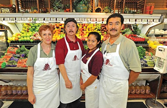 Laurel Herman, Michael King, Maria Britt and Nicolas Melara make up the culinary team at the new Good to Go Delicatessen at the West End's Good Foods Grocery. Chef King revisits recipes from his vegetarian restaurant Grace Place in the new natural foods setting. - SCOTT ELMQUIST
