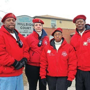Leaders of the Richmond chapter of the Guardian Angels — Mario Brandon, Karen Link, Jo White and Thomas Cox — are meeting with the Hillside Court tenants' council this week to discuss starting safety patrols.  Photo by Scott Elmquist