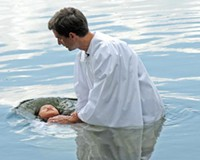 Leah Mei Ward, 8,  is baptized in the James River on July 17 by the Rev. Jim Somerville.