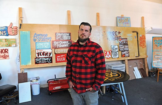 Local sign painter Ross Trimmer has watched his business grow as more customers, especially small businesses, look for ways to avoid the generic look and impersonal feel of corporate signs. - SCOTT ELMQUIST