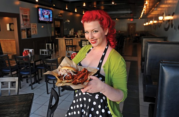 Manager Sarah Peacock shows off the new space at Bigs BBQ in the Fan, where the seitan faux pulled pork sandwich gives vegetarians a fresh option. Here it's served with sweet potato fries and slaw.