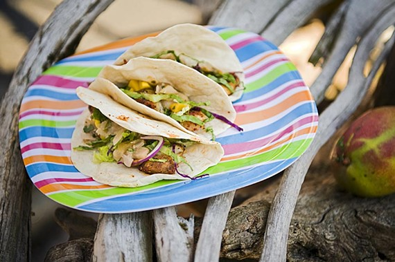 Mango salsa puts the finishing touch on fish tacos from Café Ole Carytown, prime take-out material for a spring picnic. - ASH DANIEL