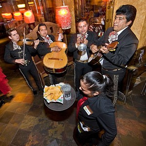 Mariachi de mi Tierra entertains patrons at Plaza Azteca, where the food and dAccor are a notch above the usual here.