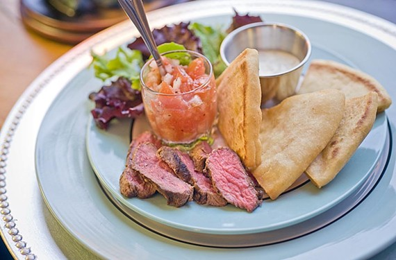 Marinated lamb is served with pita, tzatziki and a tomato-onion salad at the Peacock's Pantry in the Fan. - ASH DANIEL