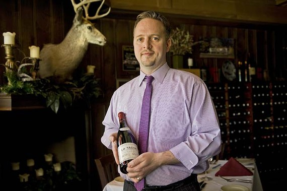 Mark Herndon, general manager at Buckhead's, with the $4,500 1999 La Tâche Grand Cru, Domaine de la Romanée-Conti. - ASH DANIEL