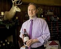 Mark Herndon, general manager at Buckhead's, with the $4,500 1999 La Tâche Grand Cru, Domaine de la Romanée-Conti.