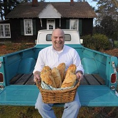 Mark McIntyre has baked bread in his North Side home for three years, but city officials now are asking him to get a business license … and perhaps a commercial kitchen. File photo by Scott Elmquist